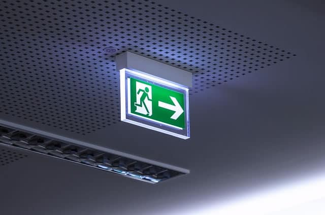 A directional sign indicating the location of an exit during emergencies evacuation